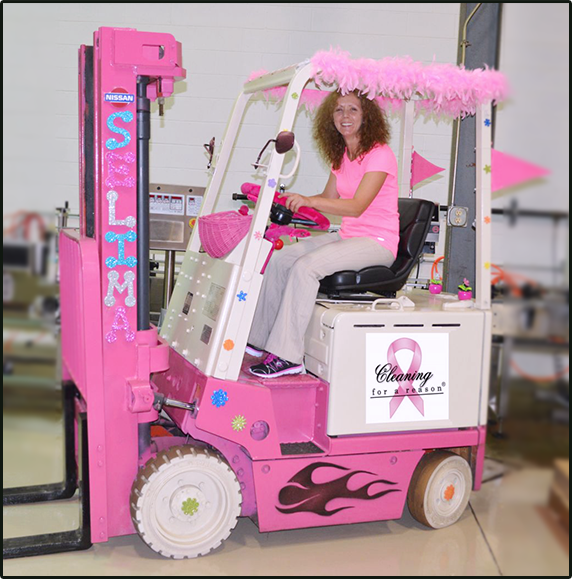 pink forklift in warehouse